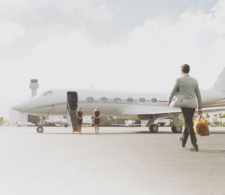 JetSmarter member walking towards a Gulfstream IV private jet